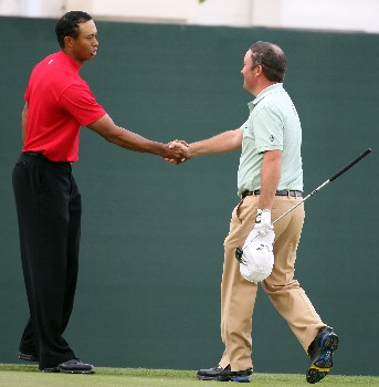 DUBAI, UNITED ARAB EMIRATES - FEBRUARY 03:  Damien McGrane of Northern Ireland and Tiger Woods of Ireland after the final round of the Dubai Desert Classic on the Majlis Course held at the Emirates Golf Club on February 3, 2008 in Dubai,United Arab Emirates.  (Photo by Ross Kinnaird/Getty Images)