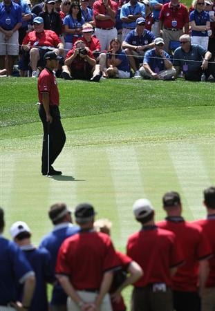 ORLANDO, FL - MARCH 16:  Tiger Woods waits to putt on the seventh hole at the Tavistock Cup on March 16, 2009 at Lake Nona Country Club in Orlando, Florida.  (Photo by Marc Serota/Getty Images)