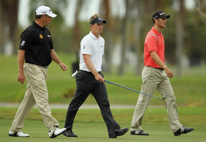 DORAL, FL - MARCH 10:  (R-L) Martin Kaymer of Germany, Luke Donald and Lee Westwood of England walk on the second hole during the first round of the 2011 WGC- Cadillac Championship at the TPC Blue Monster at the Doral Golf Resort and Spa on March 10, 2011 in Doral, Florida.  (Photo by Mike Ehrmann/Getty Images)