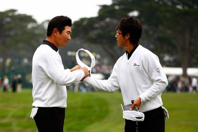 SAN FRANCISCO - OCTOBER 10:  Y.E. Yang, (L) and Ryo Ishikawa of the International Team celebrate their 3&2 victory on the 16th green green during the Day Three Morning Foursome Matches of The Presidents Cup at Harding Park Golf Course on October 10, 2009 in San Francisco, California.  (Photo by Scott Halleran/Getty Images)