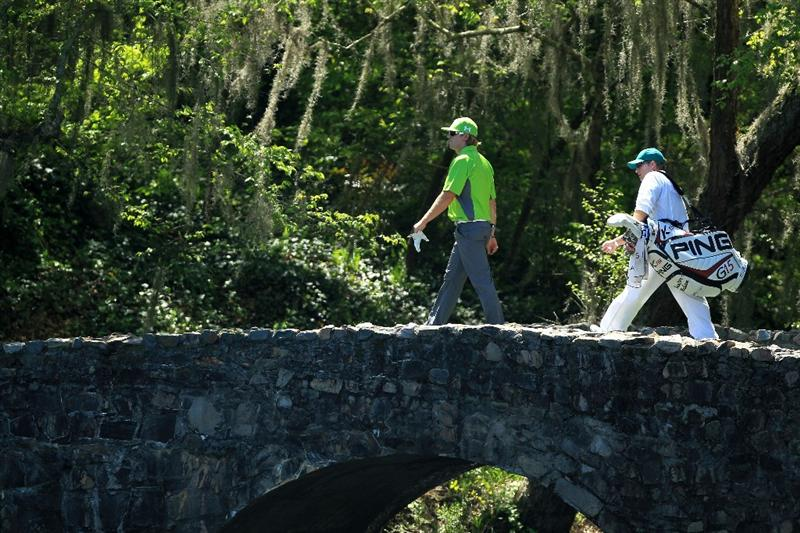 AUGUSTA, GA - APRIL 07:  Hunter Mahan walks over the Nelson bridge back to 13 tee with his caddie John Wood during the first round of the 2011 Masters Tournament at Augusta National Golf Club on April 7, 2011 in Augusta, Georgia.  (Photo by David Cannon/Getty Images)