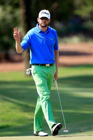 PONTE VEDRA BEACH, FL - MAY 12:  D.J. Trahan waves to fans on the 14th hole during the first round of THE PLAYERS Championship held at THE PLAYERS Stadium course at TPC Sawgrass on May 12, 2011 in Ponte Vedra Beach, Florida.  (Photo by Sam Greenwood/Getty Images)