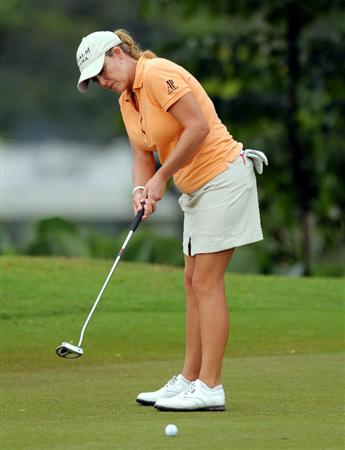 KUALA LUMPUR, MALAYSIA - OCTOBER 21:   Cristie Kerr of USA putts on the 5th hole during the Sime Darby Pro-Am at the KLGCC Golf Course on October 21, 2010 in Kuala Lumpur, Malaysia (Photo by Stanley Chou/Getty Images)
