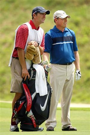 PONTE VEDRA BEACH, FL - MAY 07:  Justin Leonard (R) and his caddie Brian Smith look on from the sixth hole during the first round of THE PLAYERS Championship on THE PLAYERS Stadium Course at TPC Sawgrass on May 7, 2009 in Ponte Vedra Beach, Florida.  (Photo by Scott Halleran/Getty Images)