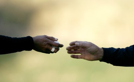 THOUSAND OAKS, CA - DECEMBER 14:  Tiger Woods (L) gets his ball back from his caddie before putting on the 16th green during the second round of the Target World Challenge at the Sherwood Country Club on December 14, 2007 in Thousand Oaks, California.  (Photo by Danny Moloshok/Getty Images)