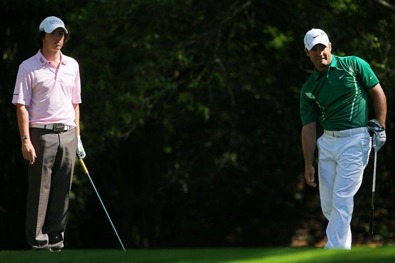 AUGUSTA, GA - APRIL 11:  Trevor Immelman of South Africa watches his tee shot on the second hole as Rory McIlroy of Northern Ireland looks on during the third round of the 2009 Masters Tournament at Augusta National Golf Club on April 11, 2009 in Augusta, Georgia.  (Photo by Andrew Redington/Getty Images)