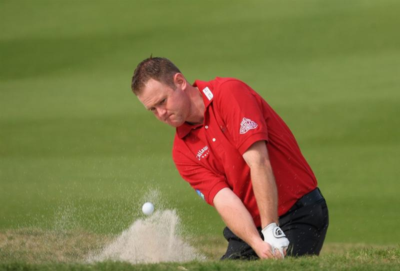 SHENZHEN, CHINA - NOVEMBER 26:  Alastair Forsyth of Scotland plays his bunker shot during the pro - am of the Omega Mission Hills World Cup at the Mission Hills Resort on November 26, 2008 in Shenzhen, China.  (Photo by Stuart Franklin/Getty Images)