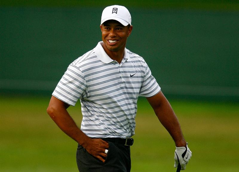 CHASKA, MN - AUGUST 10:  Tiger Woods laughs as he walks across a green during a practice round prior to the start of the 91st PGA Championship at the Hazeltine Golf Club on August 10, 2009 in Chaska, Minnesota.  (Photo by Scott Halleran/Getty Images)