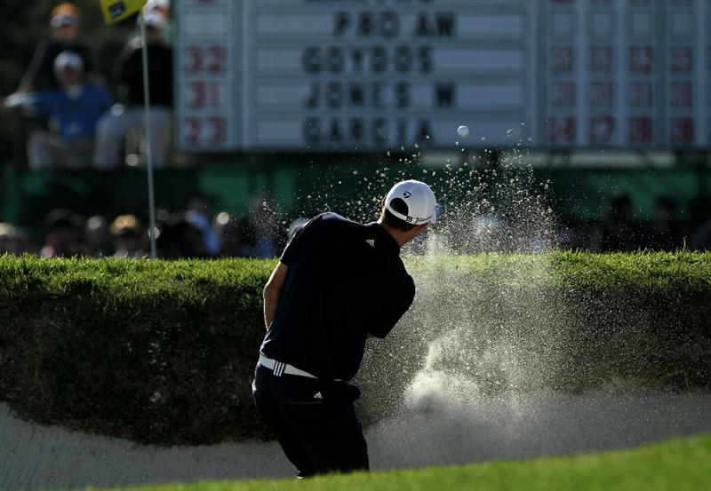 PEBBLE BEACH, CA - FEBRUARY 14:  Dustin Johnson hits out of a bunker on the 18th hole during the final round of the AT&T Pebble Beach National Pro-Am at Pebble Beach Golf Links on February 14, 2010 in Pebble Beach, California.  (Photo by Stephen Dunn/Getty Images)