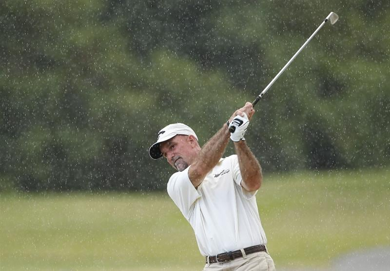 RIO GRANDE, PR - MARCH 10:  Marco Dawson hits a shot in the rain during the first round of the Puerto Rico Open presented by seepuertorico.com at Trump International Golf Club on March 10, 2011 in Rio Grande, Puerto Rico.  (Photo by Michael Cohen/Getty Images)