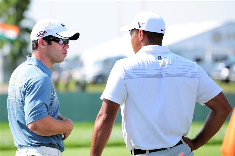 CHASKA, MN - AUGUST 12:  (L-R) Paul Casey and Tiger Woods talk during the third preview day of the 91st PGA Championship at Hazeltine National Golf Club on August 12, 2009 in Chaska, Minnesota.  (Photo by Stuart Franklin/Getty Images)