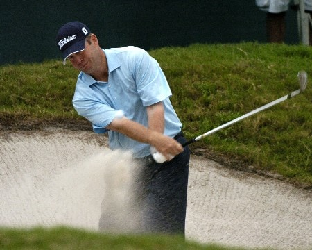 Dudley Hart blasts from the sand behind the 18th green  during first-round competition March 3, 2005  at the Ford Championship at Doral in Miami.