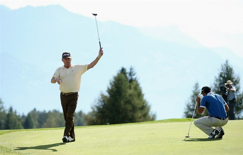 CRANS, SWITZERLAND - SEPTEMBER 05:  Miguel Angel Jimenez of Spain celebrates a birdie on the 17th green during the final round of The Omega European Masters at Crans-Sur-Sierre Golf Club on September 5, 2010 in Crans Montana, Switzerland.  (Photo by Warren Little/Getty Images)