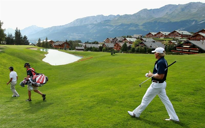 CRANS, SWITZERLAND - SEPTEMBER 02:  Greg Norman of Australia strides towards the 14th green during the first round of The Omega European Masters at Crans-Sur-Sierre Golf Club on September 2, 2010 in Crans Montana, Switzerland.  (Photo by Warren Little/Getty Images)
