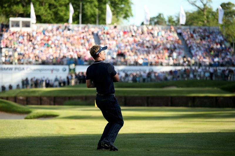 VIRGINIA WATER, ENGLAND - MAY 23:  Luke Donald of England reacts to his approach shot to the 18th green during the final round of the BMW PGA Championship on the West Course at Wentworth on May 23, 2010 in Virginia Water, England.  (Photo by Richard Heathcote/Getty Images)