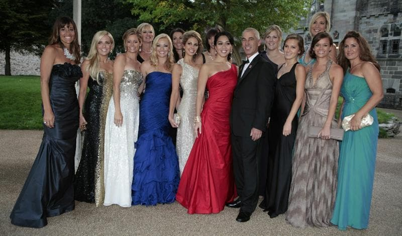 CARDIFF, UNITED KINGDOM - SEPTEMBER 29:  American Ryder Cup Team Captain Corey Pavin (C) poses with America team wives as they attend the 2010 Ryder Cup Dinner at Cardiff Castle, on September 29, 2010 in Cardiff, Wales. (Photo by Heathcliff O'Malley - WPA/Getty Images)