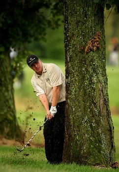 JOHANNESBURG, SOUTH AFRICA - JANUARY 11:  Ross McGowan of England plays from behind a tree on the 14th of the East Course during the second round of the Joburg Open 2008 at Royal Johannesburg & Kensington Golf Club on January 11, 2008 in Johannesburg, South Africa.  (Photo by Richard Heathcote/Getty Images)