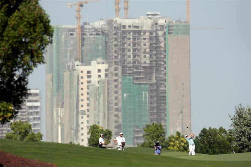 DUBAI, UNITED ARAB EMIRATES - NOVEMBER 21:  Ross McGowan of England plays his second shot at the 2nd hole during the third round of the Dubai World Championship, on the Earth Course, Jumeirah Golf Estates on November 21, 2009 in Dubai, United Arab Emirates  (Photo by David Cannon/Getty Images)