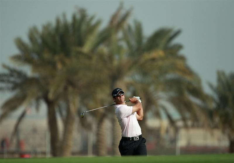BAHRAIN, BAHRAIN - JANUARY 30:  Paul Casey of England hits his second shot on the ninth hole during the final round of the Volvo Golf Champions at The Royal Golf Club on January 30, 2011 in Bahrain, Bahrain.  (Photo by Andrew Redington/Getty Images)