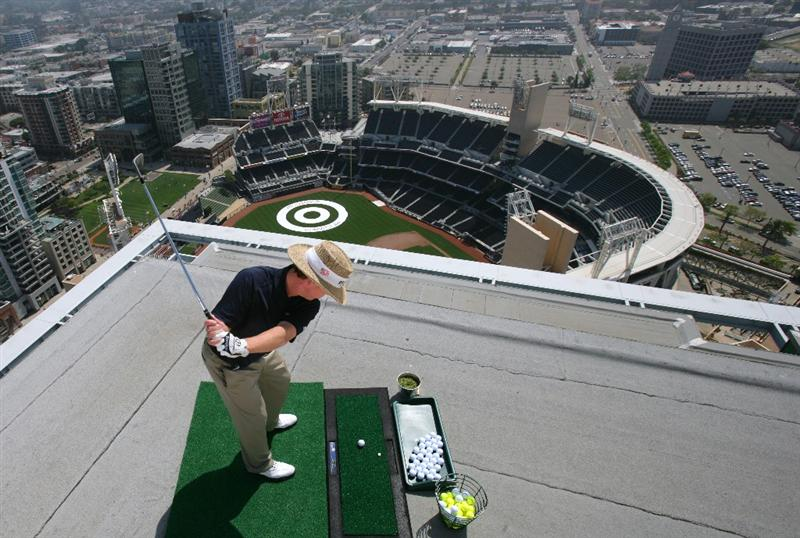SAN DIEGO - MAY 18: PGA TOUR Player Briny Baird hits off the roof of the Omni Hotel attempting to land a golf ball on a bulls-eye planted in right-center field at PETCO Park during the P.F. Chang's Chip for Charity on May 18, 2009 in San Diego, California.  (Donald Miralle/Getty Images )