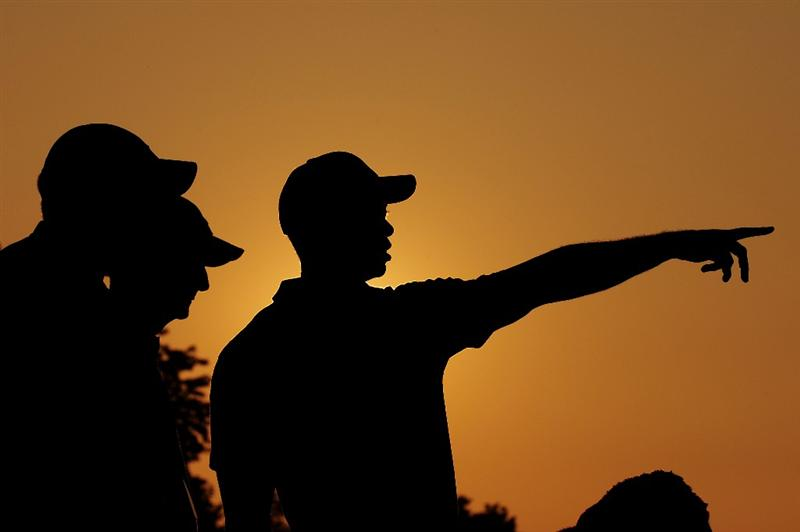 CHASKA, MN - AUGUST 11:  Tiger Woods (R) aims a shot while talking with caddie Steve Williams (L) and swing coach Hank Haney (C) during the second preview day of the 91st PGA Championship at Hazeltine National Golf Club on August 11, 2009 in Chaska, Minnesota.  (Photo by Stuart Franklin/Getty Images)