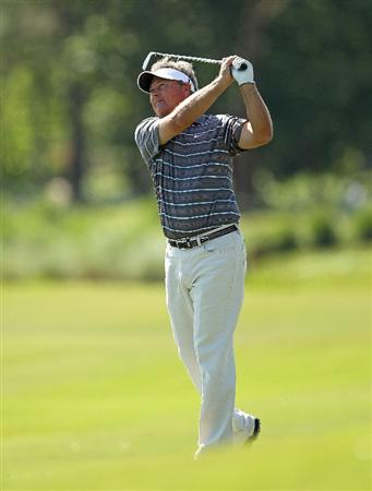 LUTZ, FL - APRIL 17: John Cook hits his approach  shot on the  fourth hole during the final round of the Outback Steakhouse Pro-Am at the TPC of Tampa on April 17, 2011 in Lutz, Florida.  (Photo by Mike Ehrmann/Getty Images)