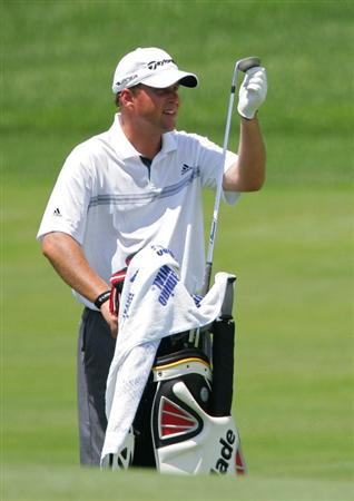 SILVIS, IL - JULY 11:  Matt Bettencourt of the USA prepares to play a shot during the continuation of the second round of the John Deere Classic at TPC Deere Run held on July 11, 2009 in Silvis, Illinois.  (Photo by Michael Cohen/Getty Images)