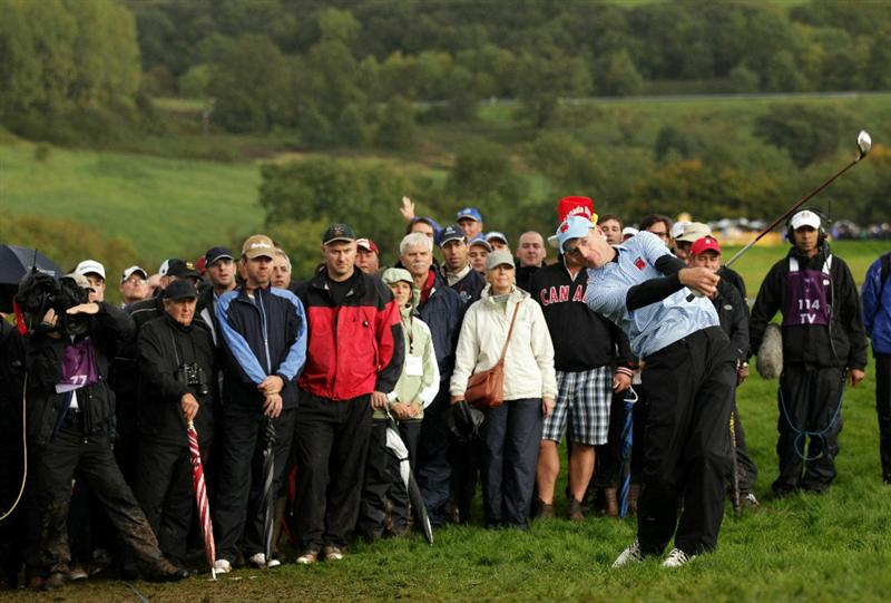 NEWPORT, WALES - OCTOBER 03:  Jim Furyk of the USA hits a shot from the rough during the  Fourball & Foursome Matches during the 2010 Ryder Cup at the Celtic Manor Resort on October 3, 2010 in Newport, Wales.  (Photo by Andrew Redington/Getty Images)