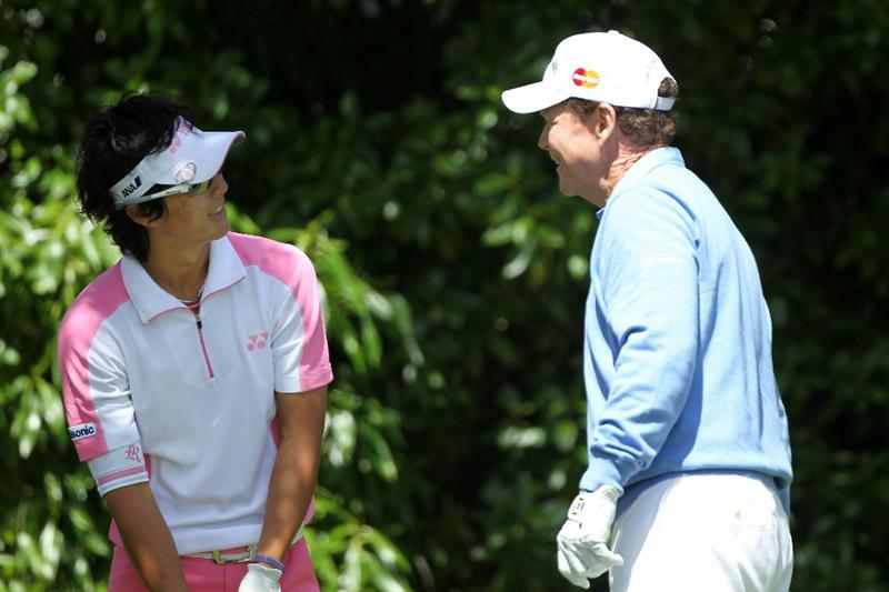 PEBBLE BEACH, CA - JUNE 17:  Tom Watson (R) and Ryo Ishikawa of Japan wait on the 16th tee during the first round of the 110th U.S. Open at Pebble Beach Golf Links on June 17, 2010 in Pebble Beach, California.  (Photo by Donald Miralle/Getty Images)