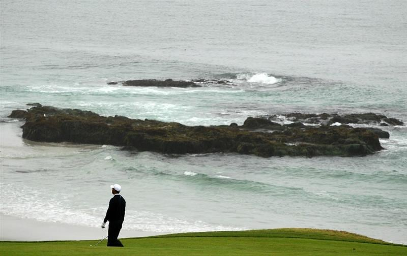 PEBBLE BEACH, CA - JUNE 14:  Tiger Woods walks to his second shot during a practice round prior to the start of the 110th U.S. Open at Pebble Beach Golf Links on June 14, 2010 in Pebble Beach, California.  (Photo by Scott Halleran/Getty Images)