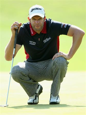 NEWPORT, WALES - JUNE 03:  Bradley Dredge of Wales lines up a putt on the 16th hole during the first round of the Celtic Manor Wales Open on The Twenty Ten Course at The Celtic Manor Resort on June 3, 2010 in Newport, Wales.  (Photo by Andrew Redington/Getty Images)