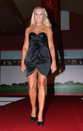SINGAPORE - MARCH 04:  Natalie Gulbis of the USA on the catwalk at the 'Welcolm Reception' prior to the HSBC Women's Championship at the Tanah Merah Country Club on March 4, 2009 in Singapore.  (Photo by Ross Kinnaird/Getty Images)