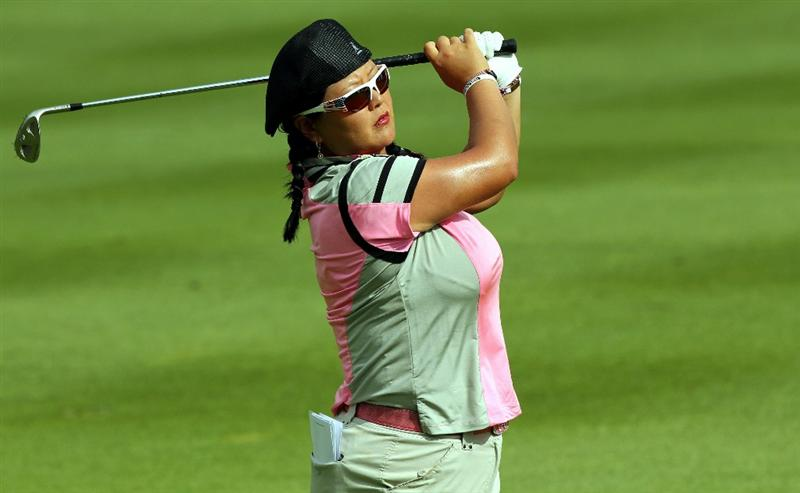 KUALA LUMPUR, MALAYSIA - OCTOBER 24:  Christina Kim of USA watches her 2nd tee shot on the 1st hole during the Final Round of the Sime Darby LPGA on October 24, 2010 at the Kuala Lumpur Golf and Country Club in Kuala Lumpur, Malaysia. (Photo by Stanley Chou/Getty Images)