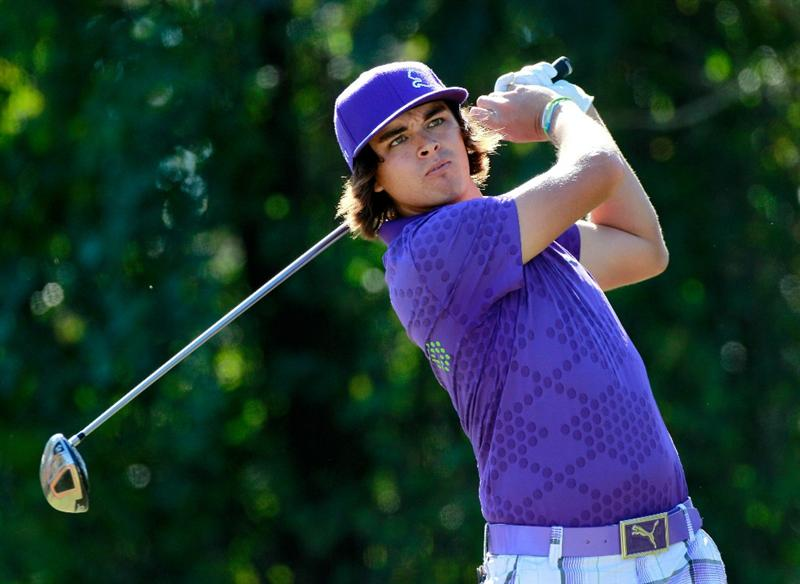 LAKE BUENA VISTA, FL - NOVEMBER 13:  Rickie Fowler hits a shot on the 4th hole during the third round of the Children's Miracle Network Classic at the Disney Palm and Magnolia course on November 13, 2010 in Lake Buena Vista, Florida.  (Photo by Sam Greenwood/Getty Images)