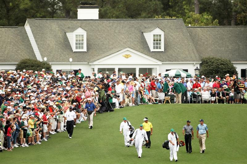 AUGUSTA, GA - APRIL 08:  Tiger Woods, Matt Kuchar and K.J. Choi of Korea walk off the first tee with their caddies during the first round of the 2010 Masters Tournament at Augusta National Golf Club on April 8, 2010 in Augusta, Georgia.  (Photo by Andrew Redington/Getty Images)