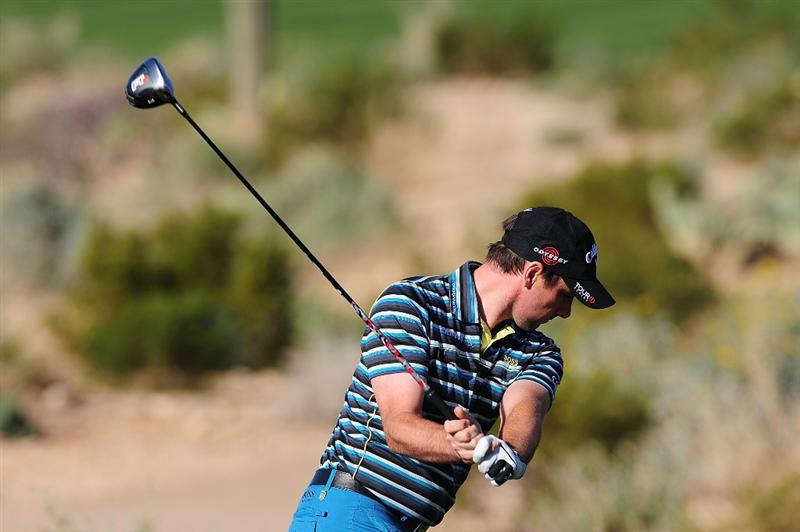 MARANA, AZ - FEBRUARY 18:  Oliver Wilson of England tees off on the second hole during round two of the Accenture Match Play Championship at the Ritz-Carlton Golf Club on February 18, 2010 in Marana, Arizona.  (Photo by Stuart Franklin/Getty Images)