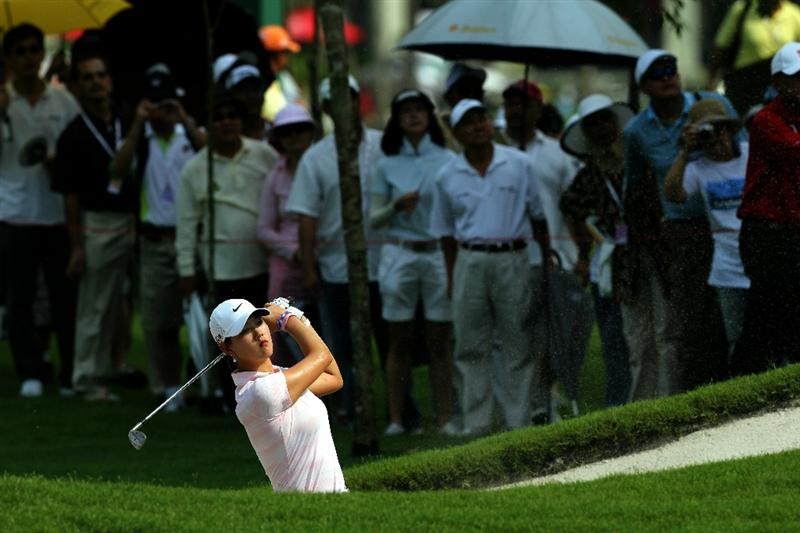 KUALA LUMPUR, MALAYSIA - OCTOBER 23: Michelle Wie of USA hits her bunker shot on the 1st hole during Round Two of the Sime Darby LPGA on October 23, 2010 at the Kuala Lumpur Golf and Country Club in Kuala Lumpur, Malaysia. (Photo by Stanley Chou/Getty Images)
