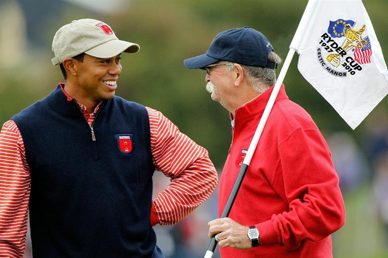 NEWPORT, WALES - SEPTEMBER 30:  Caddie Mike Cowan chats with Tiger Woods of the USA during a practice round prior to the 2010 Ryder Cup at the Celtic Manor Resort on September 30, 2010 in Newport, Wales.  (Photo by Sam Greenwood/Getty Images)