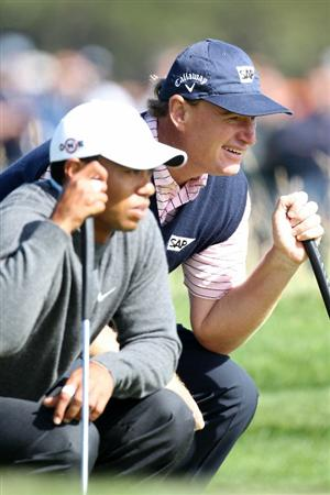 PEBBLE BEACH, CA - JUNE 17:  Tiger Woods and Ernie Els of South Africa line up a putt on the tenth hole during the first round of the 110th U.S. Open at Pebble Beach Golf Links on June 17, 2010 in Pebble Beach, California.  (Photo by Ross Kinnaird/Getty Images)