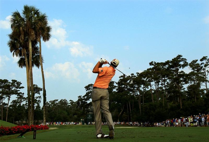PONTE VEDRA BEACH, FL - MAY 12:  Matt Kuchar hits his tee shot on the third hole during the first round of THE PLAYERS Championship held at THE PLAYERS Stadium course at TPC Sawgrass on May 12, 2011 in Ponte Vedra Beach, Florida.  (Photo by Streeter Lecka/Getty Images)