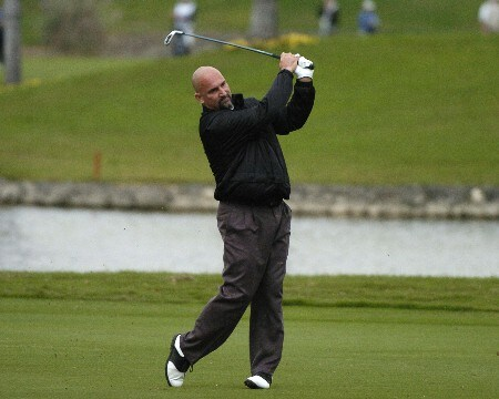 Marco Dawson hits from the 18th fairway during first-round competition March 3, 2005  at the Ford Championship at Doral in Miami. Dawson finished eight under par to tie for first.