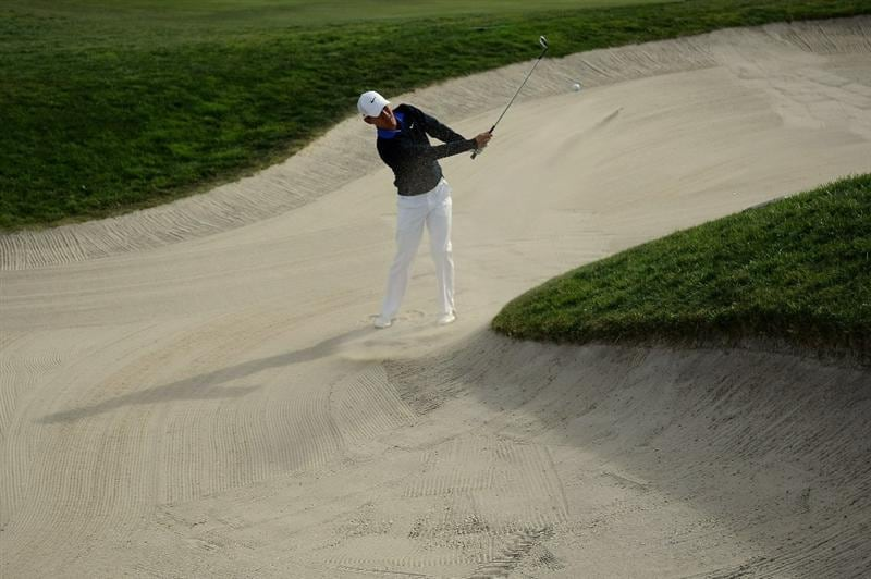 LA JOLLA, CA - JANUARY 30: Anthony Kim hits out of the 15th hole bunker during the final round of the Farmers Insurance Open on January 30, 2011 in La Jolla, California.  (Photo by Donald Miralle/Getty Images)