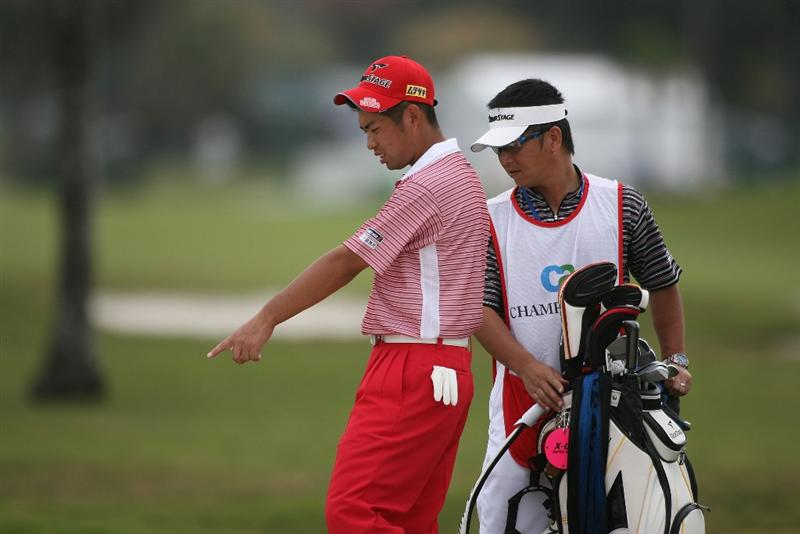 DORAL, FL - MARCH 11:  Yuta Ikeda of Japan plays a shot on the  during round one of the 2010 WGC-CA Championship at the TPC Blue Monster at Doral on March 11, 2010 in Doral, Florida.  (Photo by Marc Serota/Getty Images)