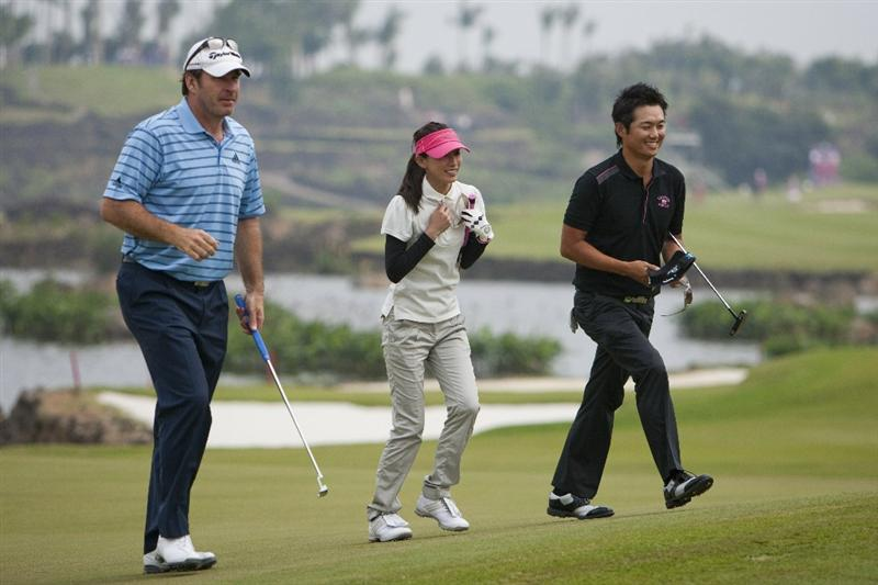 HAIKOU, CHINA - OCTOBER 31: Golfer Sir Nick Faldo, Japan actor Ai Kato and Golfer Ryuji Imada of Japan in action during day five of the Mission Hills Start Trophy tournament at Mission Hills Resort on October 31, 2010 in Haikou, China. The Mission Hills Star Trophy is Asia's leading leisure liflestyle event which features Hollywood celebrities and international golf stars.  (Photo by Athit Perawongmetha/Getty Images for Mission Hills)