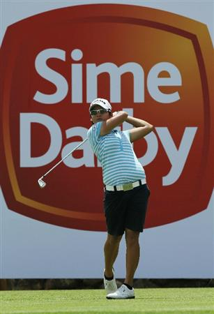 KUALA LUMPUR, MALAYSIA - OCTOBER 22: Yani Tseng of Taiwan tees off on the 10th hole during Round One of the Sime Darby LPGA on October 22, 2010 at the Kuala Lumpur Golf and Country Club in Kuala Lumpur, Malaysia. (Photo by Stanley Chou/Getty Images)