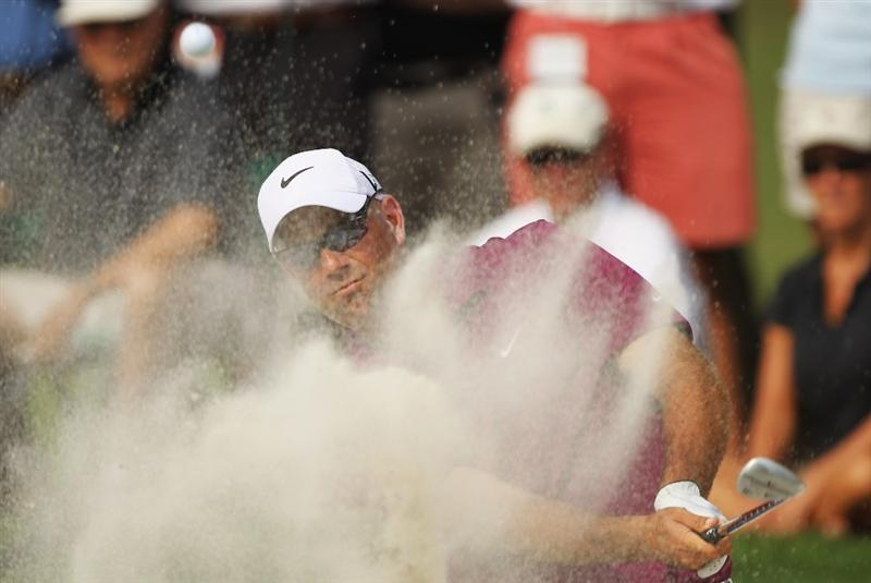 CHARLOTTE, NC - MAY 07:  Stewart Cink plays a bunker shot on the tenth hole during the third round of the Wells Fargo Championship at the Quail Hollow Club on May 7, 2011 in Charlotte, North Carolina.  (Photo by Scott Halleran/Getty Images)