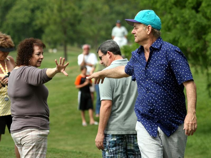 LUTZ, FL - APRIL 19: Actor Bill Murray (R) jokes with spectator Gail DiMaggio (L) on the ninth hole during the final round of the Outback Steakhouse Pro-Am at TPC Tampa Bay on April 19, 2009  in Lutz, Florida. Murray's tee shot struck DiMaggio in the head on the same hole while she was standing in her back yard during the first round of play on Friday. DiMaggio was taken to the hospital, but she was released the same day. (Photo by Marc Serota/Getty Images)
