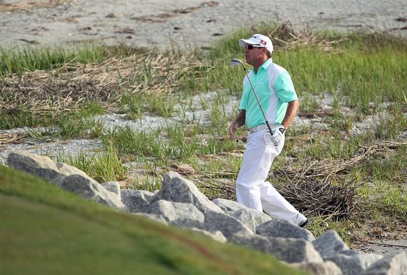 HILTON HEAD ISLAND, SC - APRIL 18:  Brian Davis of England plays a shot from the beach on the first playoff hole during the final round of the Verizon Heritage at the Harbour Town Golf Links on April 18, 2010 in Hilton Head lsland, South Carolina.  (Photo by Scott Halleran/Getty Images)