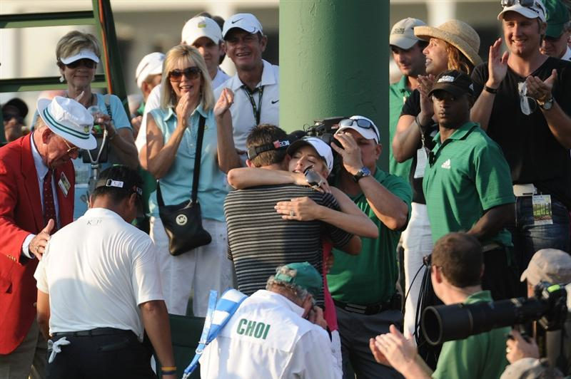 AUGUSTA, GA - APRIL 10:  Charl Schwartzel of South Africa celebrates his two-stroke victory with his wife Rosalind behind the 18th green during the final round of the 2011 Masters Tournament at Augusta National Golf Club on April 10, 2011 in Augusta, Georgia.  (Photo by Harry How/Getty Images)
