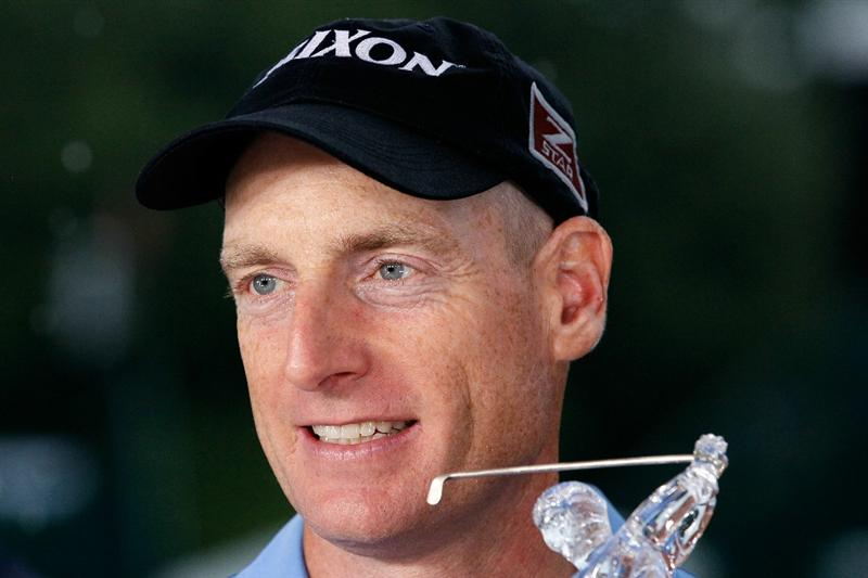 ATLANTA - SEPTEMBER 26:  Jim Furyk celebrates with THE TOUR Championship trophy after winning THE TOUR Championship presented by Coca-Cola, the final event of the PGA TOUR Playoffs for the FedExCup, at East Lake Golf Club on September 26, 2010 in Atlanta, Georgia.  (Photo by Kevin C. Cox/Getty Images)